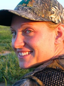 A woman smiles on her first hunt.